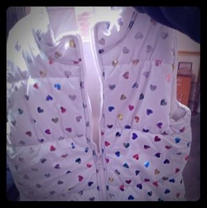 Girls puffy vest with multi colored hearutsarys